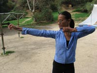 Zoe Saldana training on the archery range.